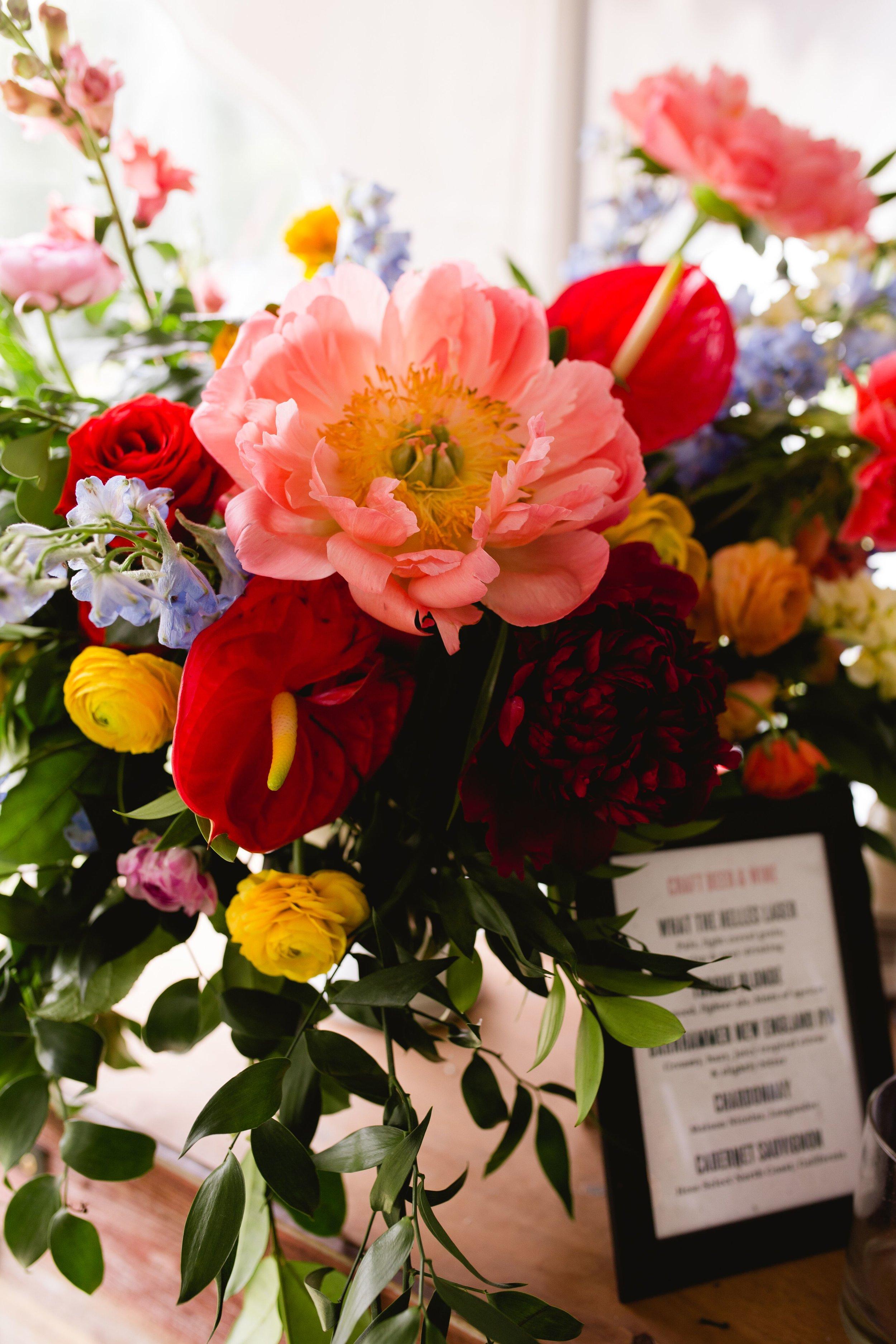 Colourful wedding bar flowers