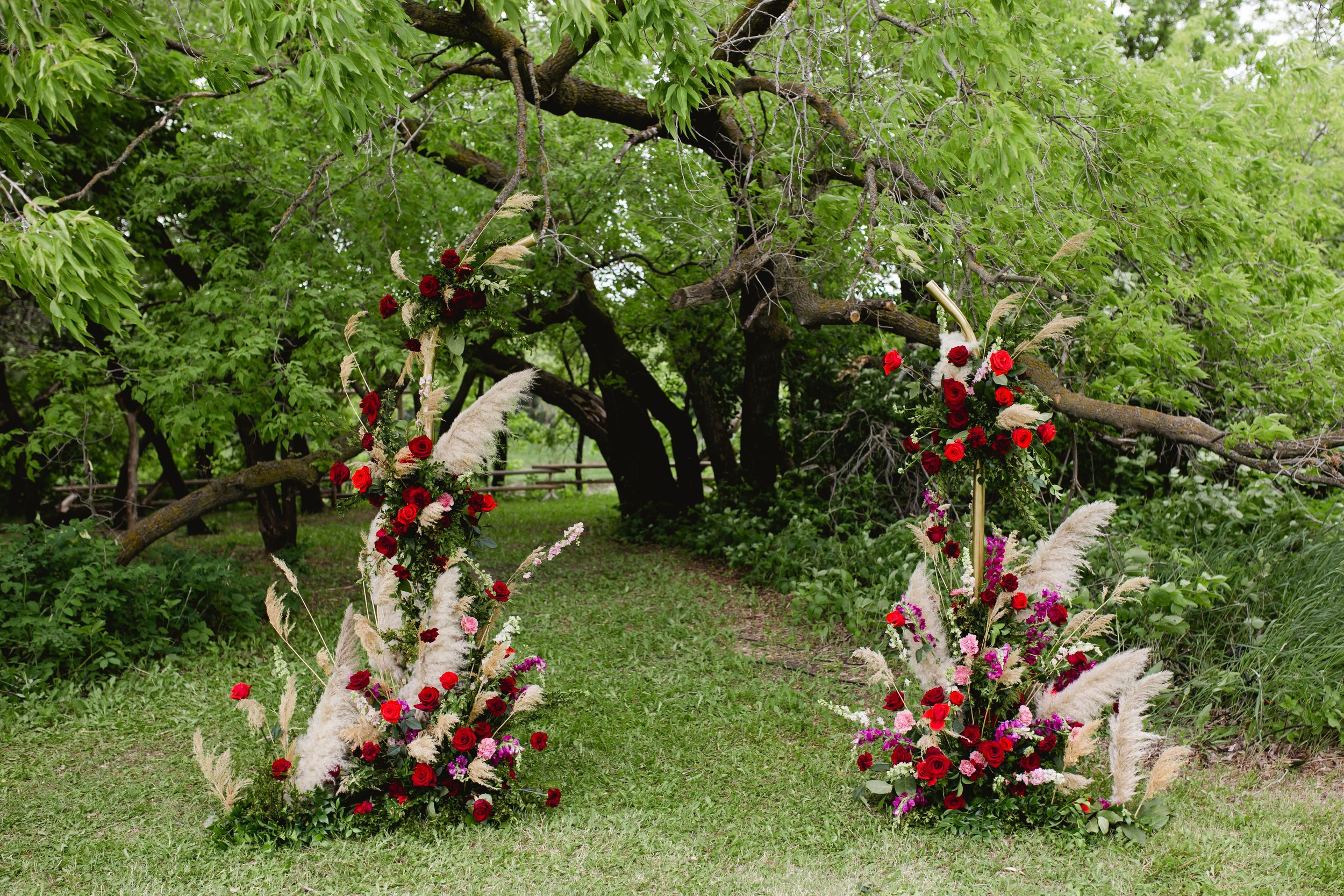 Ceremony arch with red flowers