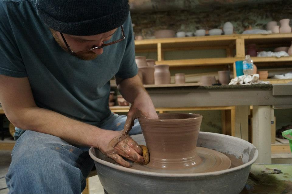 """Throwing"" on a potter's wheel"