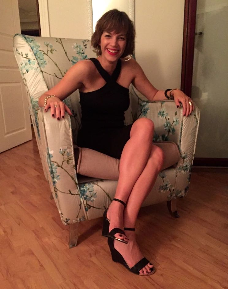 Sitting in blue flowers chair