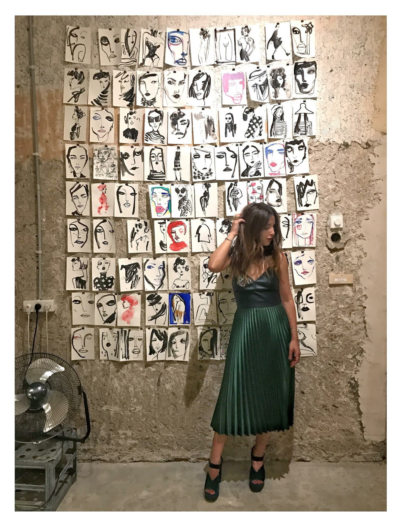 Shira Barzilay In Front Of Her Illustrations