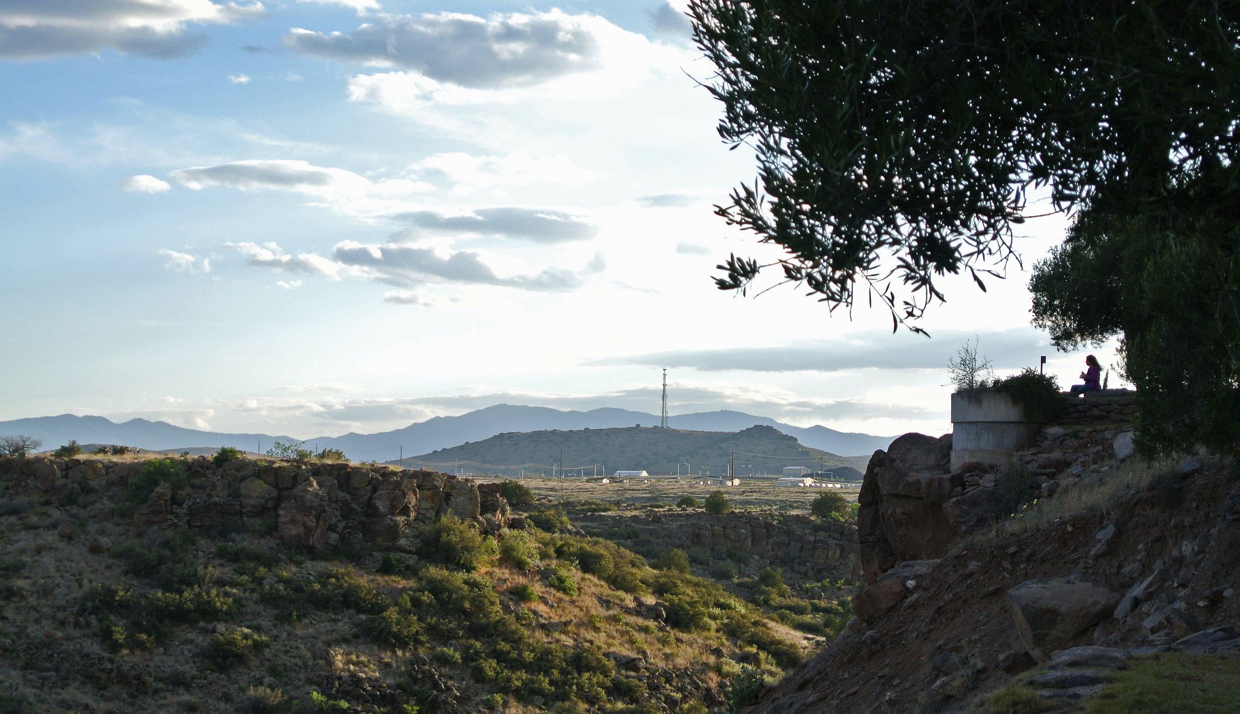 A visitor overlooks the landscape at Arcosanti  © Shannon Moore