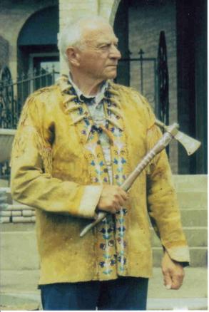 Wilbur E. Ternyik, whose ancestors were Clatsop Indians, wearing his buckskin jacket and carrying his tomahawk.