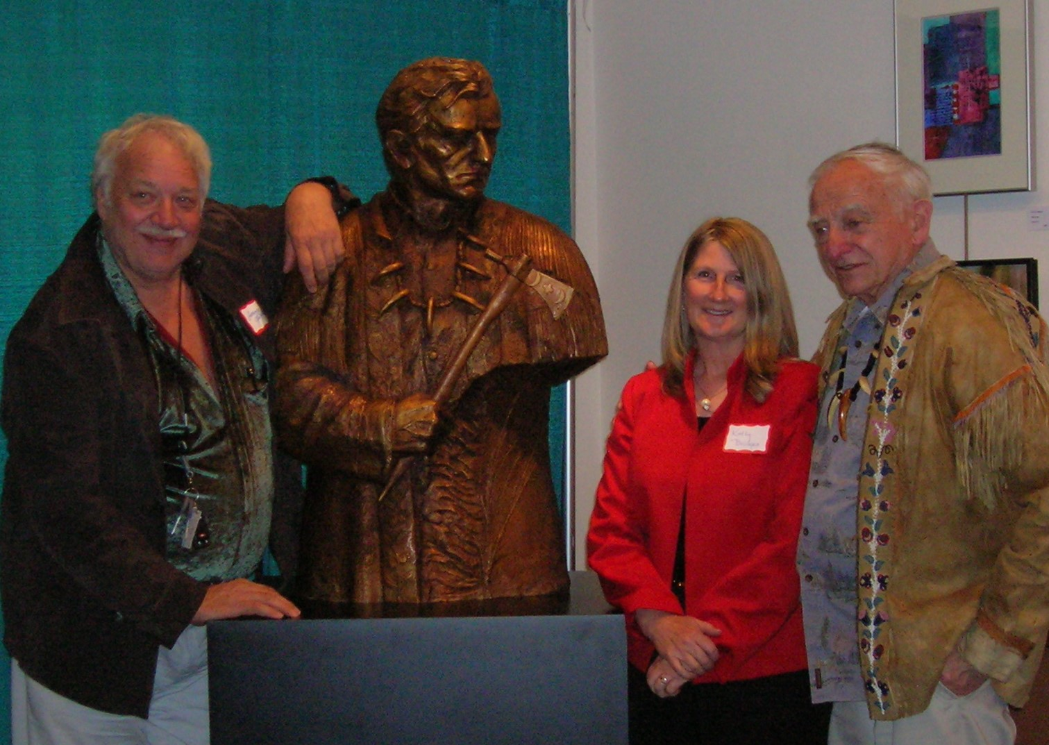 Wilbur E. Ternyik (right) honored in Florence, OR Lorenzo E. Ghiglieri, artist, presenting bronze with Kathy Bridges, The Bridges Foundation