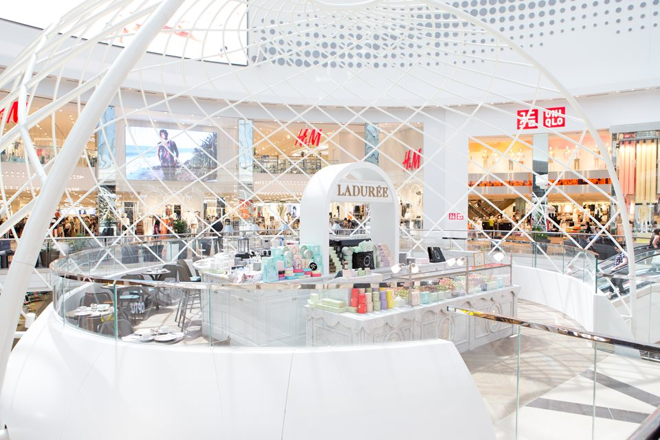Laduree Chadstone  - strategically placed as a pitstop outside the specific food precinct zones within the centre  (image via Hospitality Magazine)