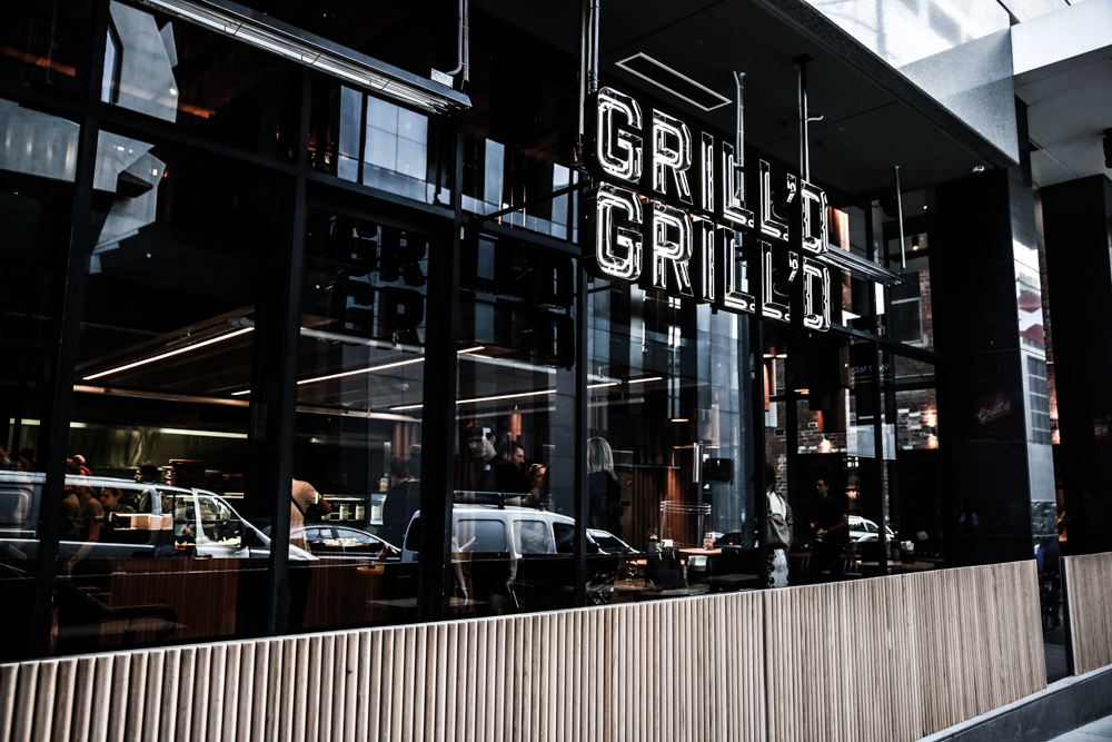 Grill'd, Flinders Lane - designed by  Techne Architects  ( image via  Couturing  )