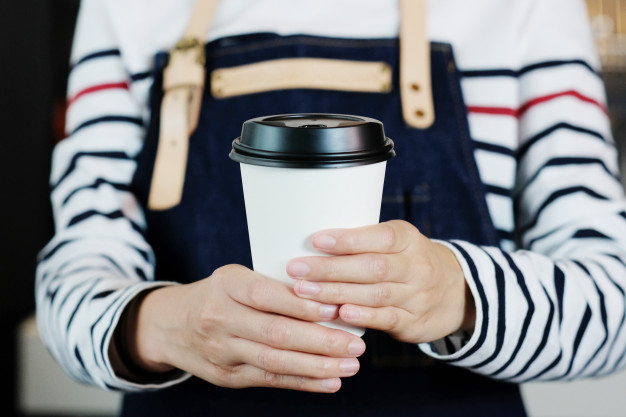 barista-holds-take-away-coffee-cup_7190-1138.jpg