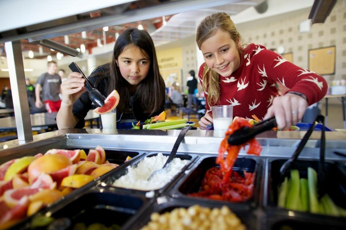 Kids eating healthy at their School Salad Bar