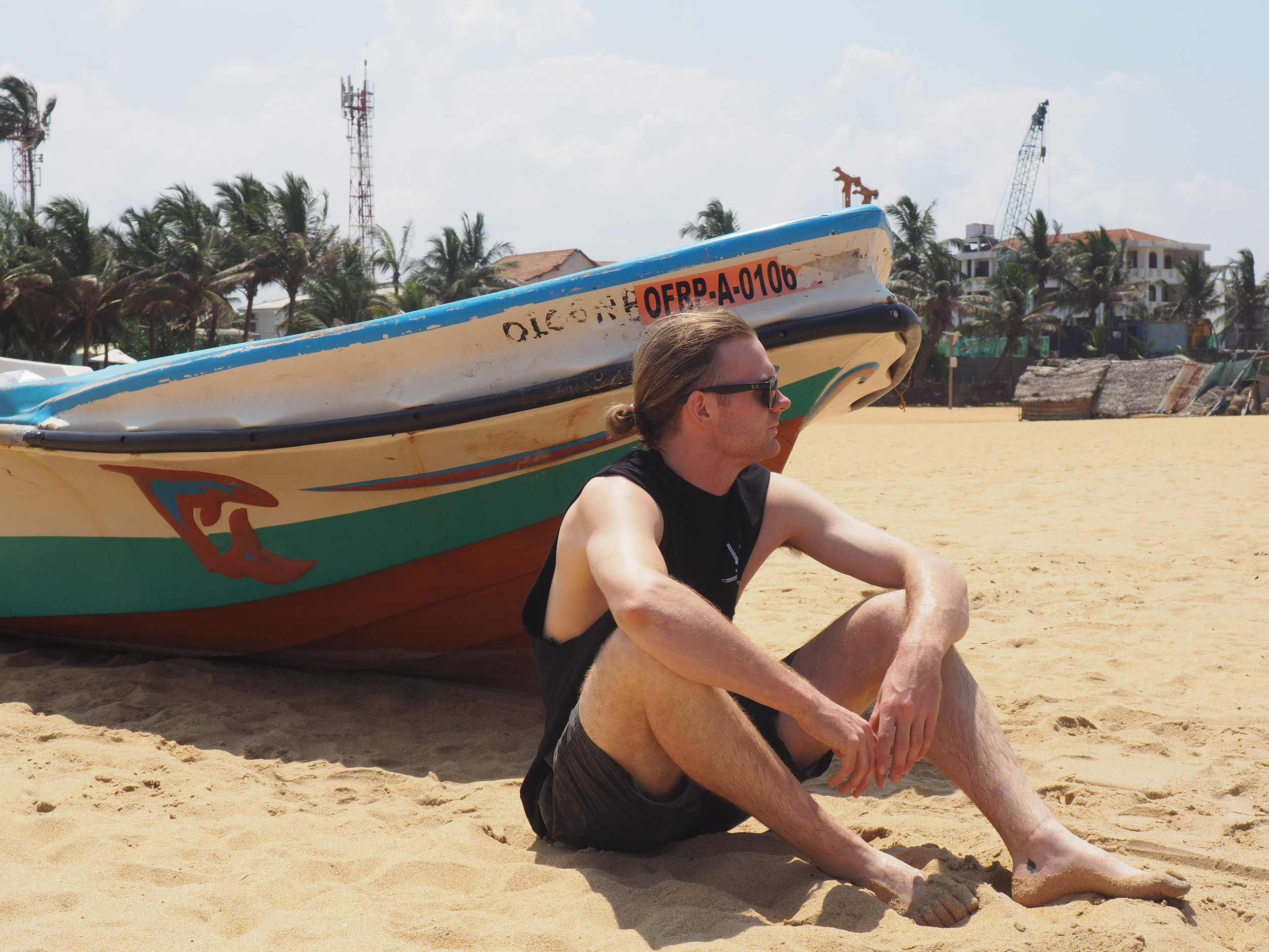 Negombo - Lawson and fishing boat.JPG