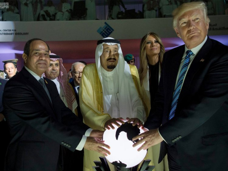 The leaders of Egypt, Saudi Arabia, and America, who solidified their partnership by touching a glowing orb.