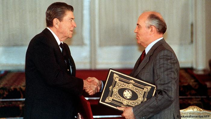 Gorbachev and Reagan signing the INF Treaty
