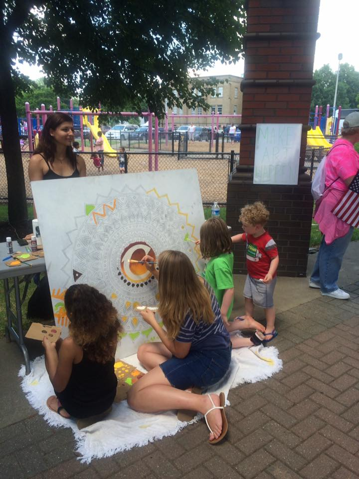 Artist Ly Canfield at the Firestone Park Community Celebration in June 2016.