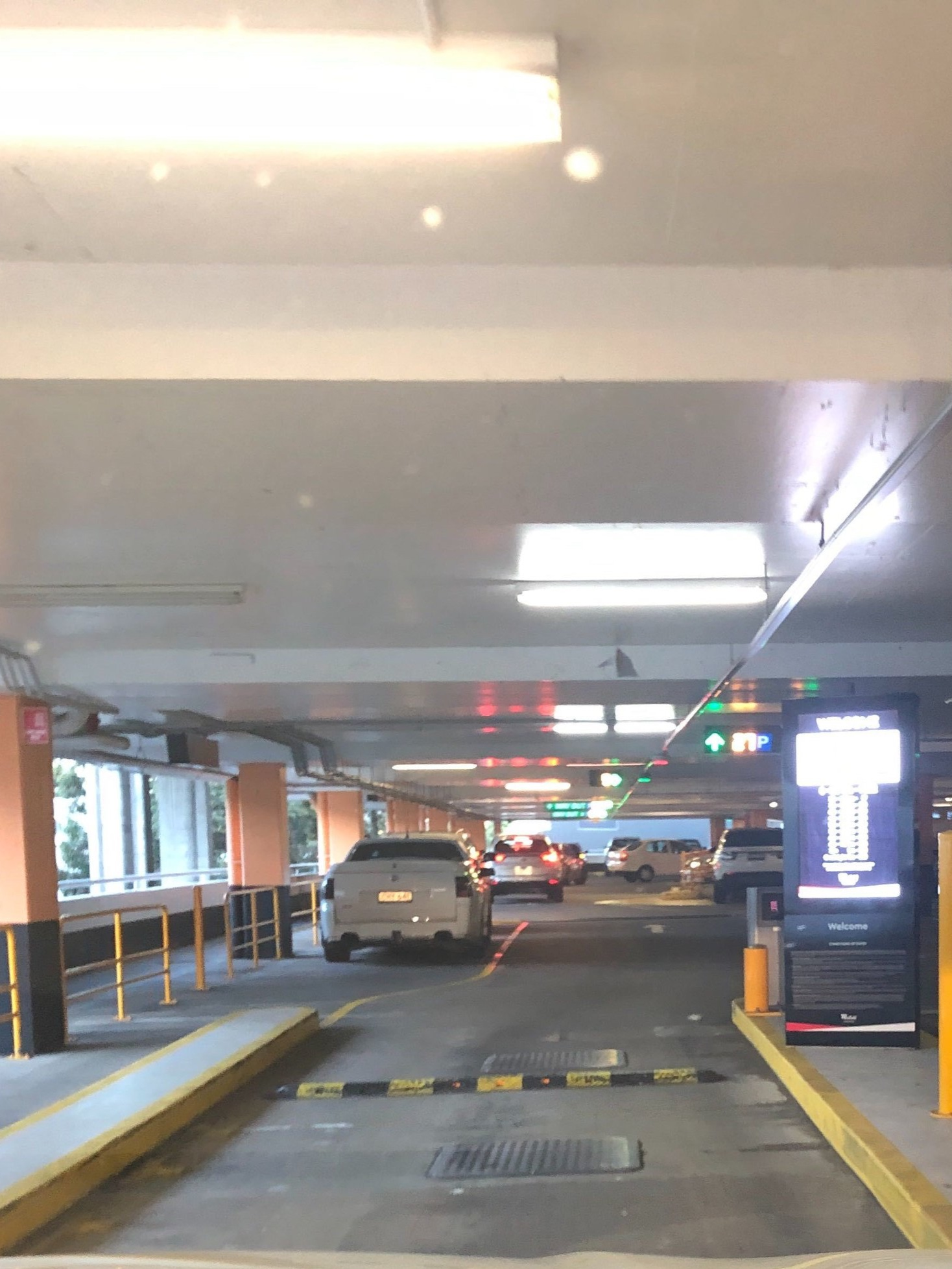 Enter the parking lot and on the right hand side there should be a ramp to upper level parking