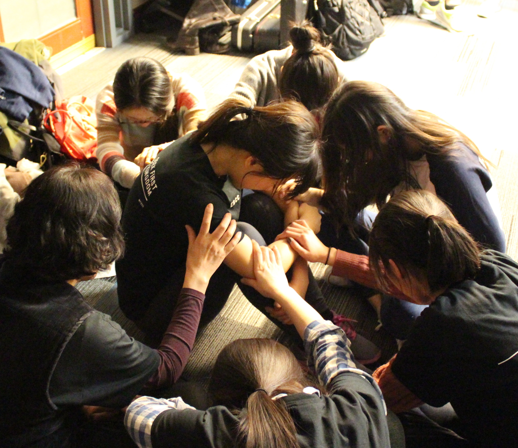 sisters in Christ praying for each other