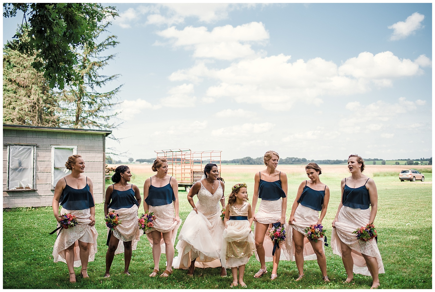 badger farms wisconsin wedding, wisconsin wedding, summer wedding, madison wedding, madison summer wedding, traveling photographer, badger farms, wedding party, bridal party, navy blue bridesmaids dresses, white lace wedding dress, diamond necklace, summer flower bouquet, outdoor wedding, flower girl