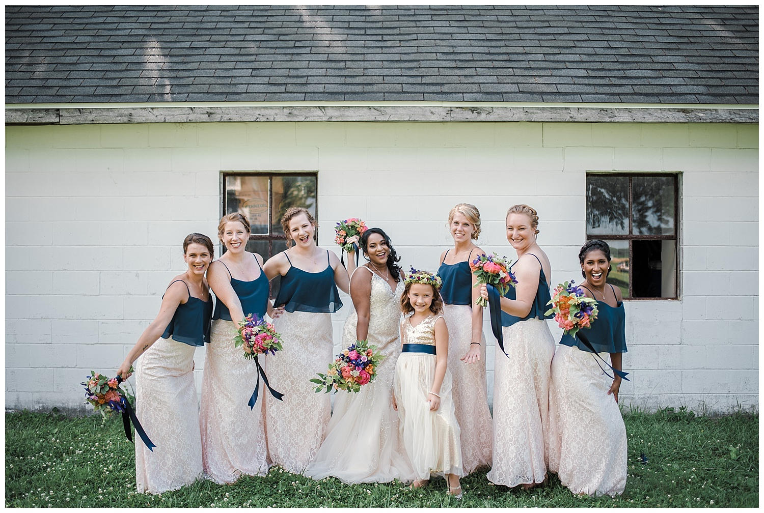 badger farms wisconsin wedding, wisconsin wedding, summer wedding, madison wedding, madison summer wedding, traveling photographer, badger farms, wedding party, bridal party, navy blue bridesmaids dresses, white lace wedding dress, diamond necklace, summer flower bouquet, outdoor wedding
