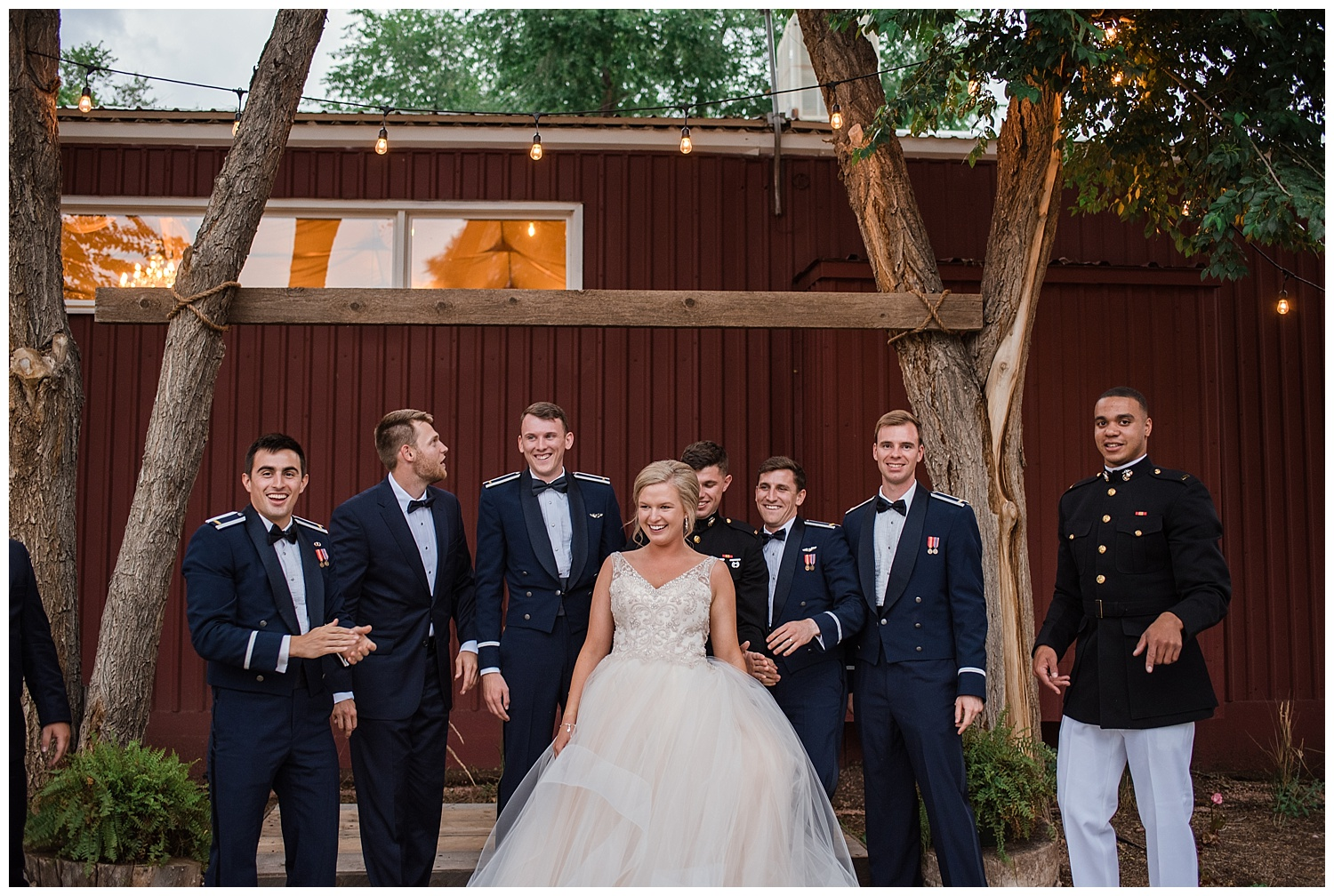 Military Wedding, bride and her groomsmen smiling, bridal party, dress blues, groomsmen, bridesmaids, dress blues, Colorado Wedding Photographer, Denver Wedding Photographer, Denver Elopement Photographer, Colorado Elopement Photographer, Rocky Mountain Wedding Photographer, Downtown Denver Photographer, colorado springs wedding photographer