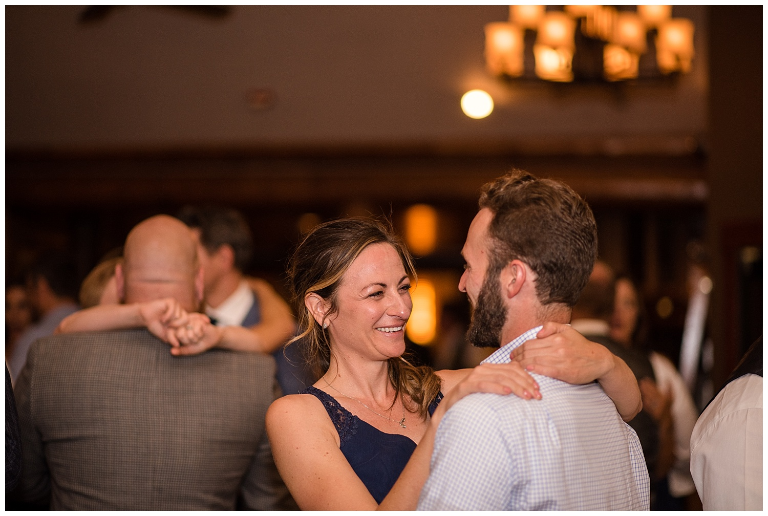 wedding guests dancing at estes park resort, rocky mountain elopement photographer, rocky mountain wedding photographer, colorado wedding photographer, Estes Park wedding photographer