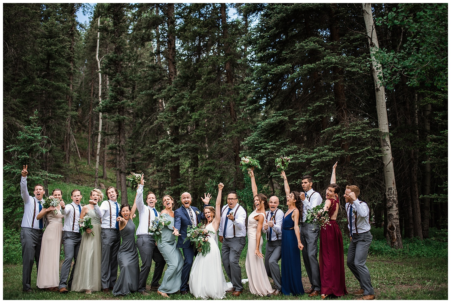 wedding party portraits at Beaver Ranch in Conifer Colorado, Colorado Wedding Photographer, Rocky Mountain Wedding Photographer, Intimate Colorado Wedding Photographer, bridesmaids laughing in jewel toned dresses