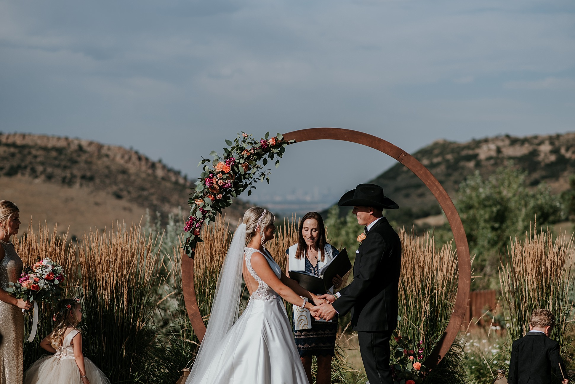 The manor house wedding, the manor house wedding photographer, denver wedding photographer, colorado elopement photographer, colorado wedding photographer, denver wedding videographer, colorado wedding videographer, denver wedding photographer and videographer, floral arch ceremony