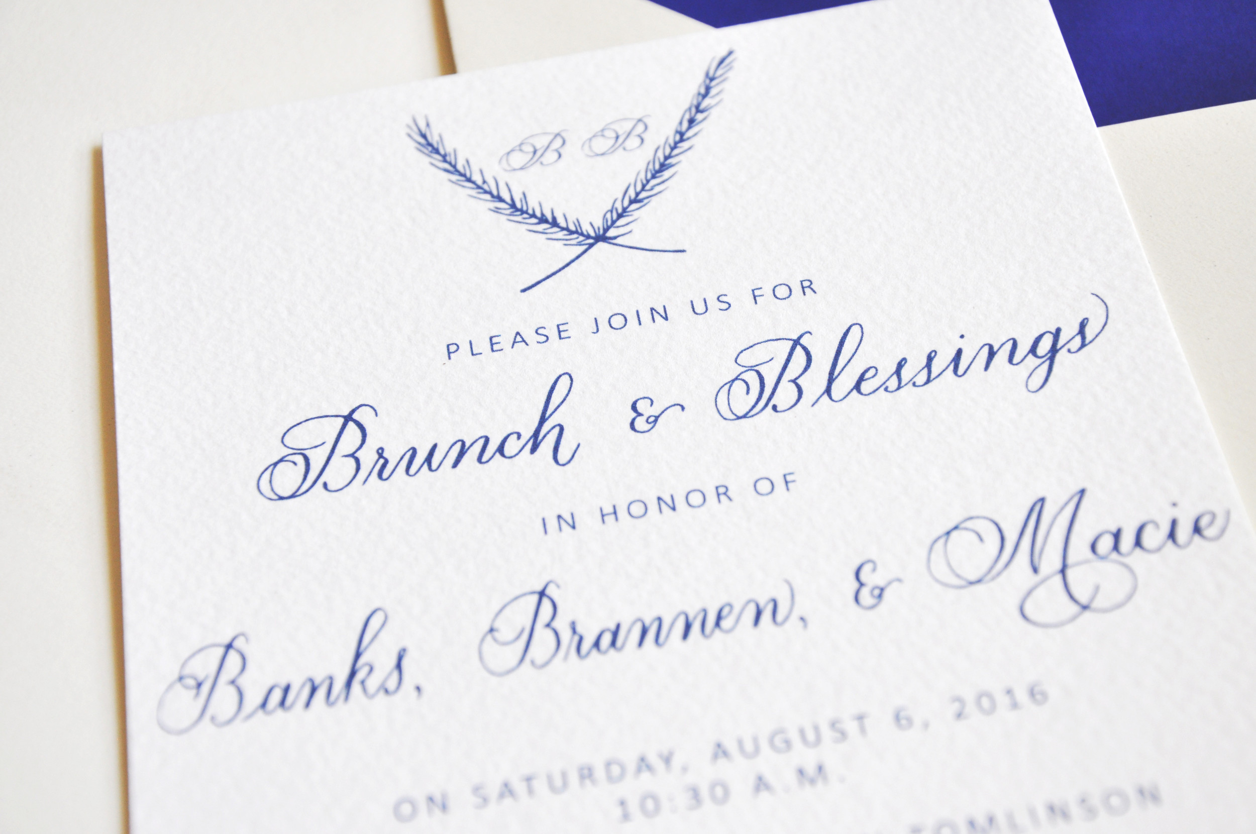 For this invitation, I used pointed-pen calligraphy to create the handmade elements of the invitation.  First, I designed a classic monogram that featured the initials of the twin boys' first names.  I enclosed the letters in a simple rustic wreath.  Then, I drew the rest of the handmade elements in traditional copperplate calligraphy.