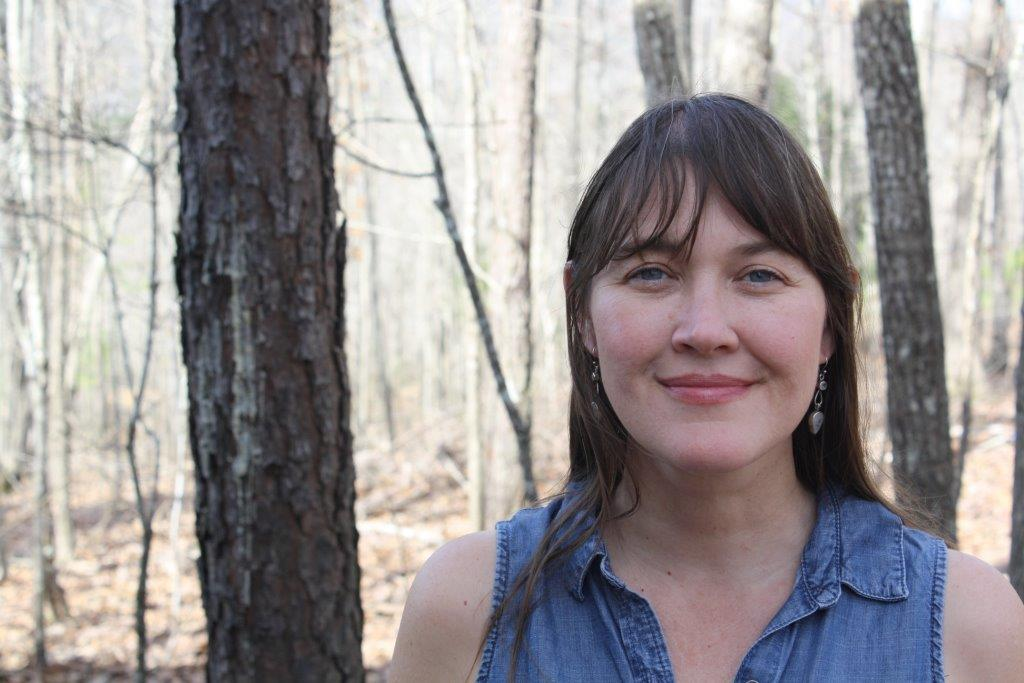 """Tina Mozelle Braziel - """"The dirt-sex scent of tomatoes"""" is the best line Tina Mozelle Braziel has written so far. Winner of the 2017 Philip Levine Prize for Poetry, she loves writing in the glass cabin that she and her husband are building on Hydrangea Ridge.Her chapbook,Rooted by Thirst (Porkbelly Press), and her forthcoming book,Known by Salt (Anhinga Press), detail some of her home building adventures."""