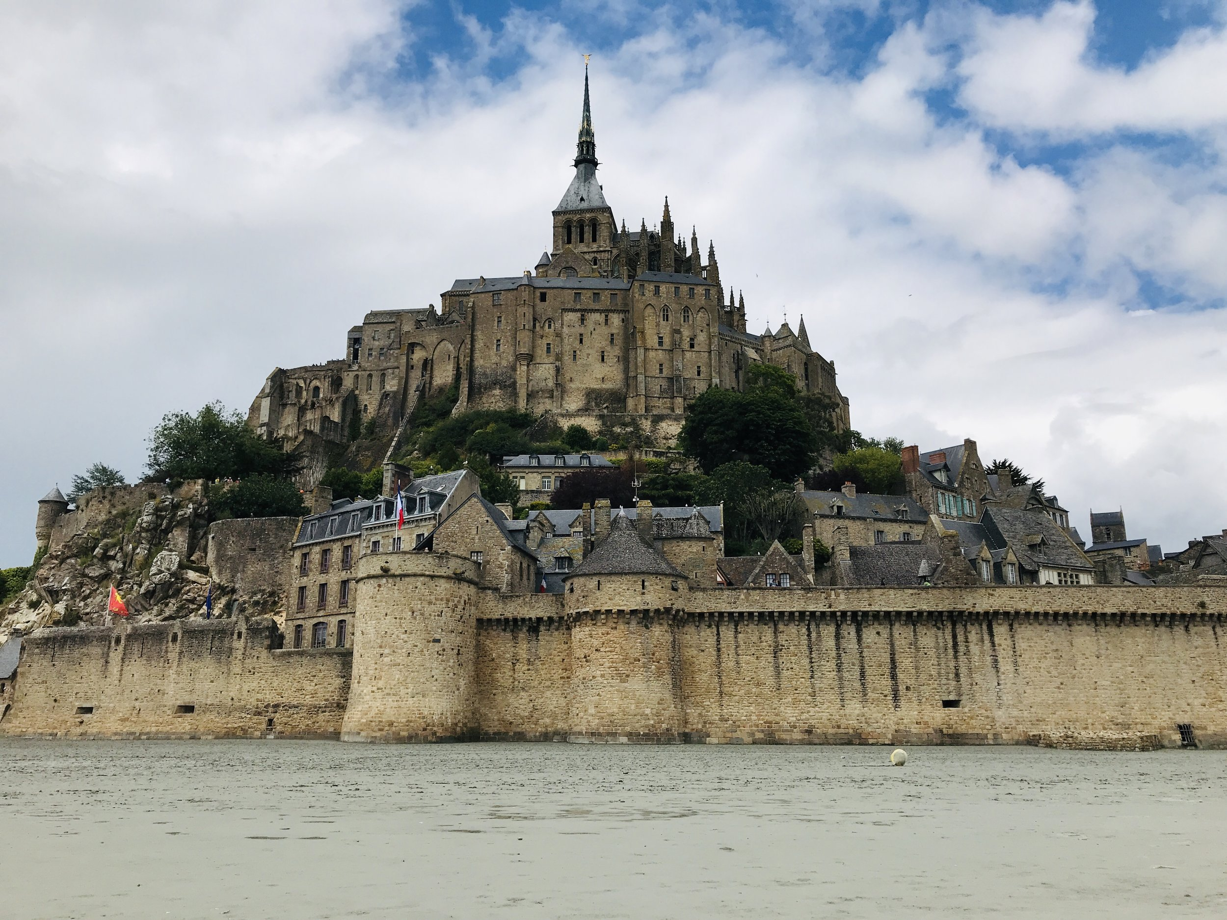 Mont Saint-Michel - Benedictine abbey on an island where the extreme tides of Normandy isolate it from everything.