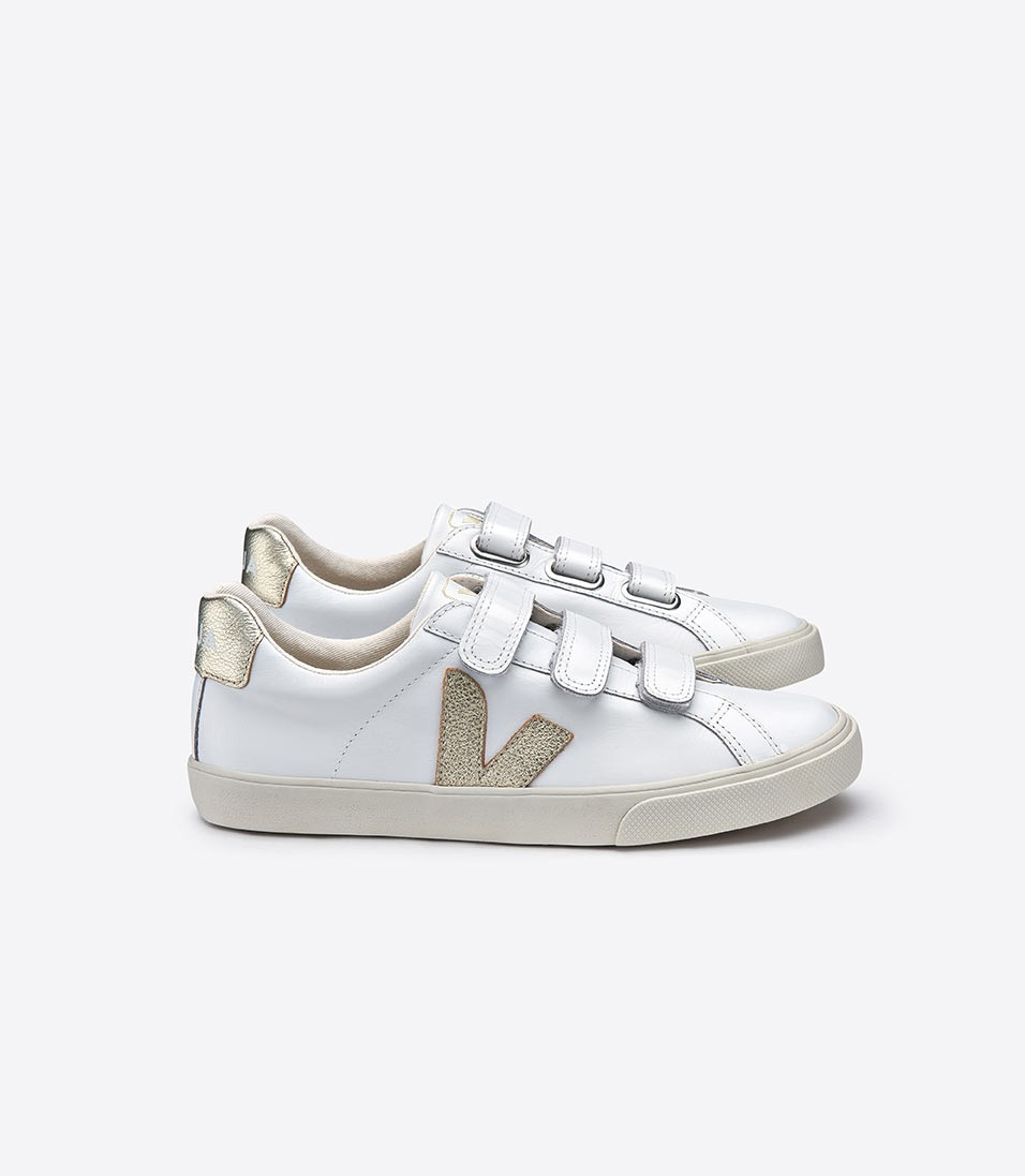 Veja gold velcro sneakers. I'm a big fan of this sustainable French sneaker brand. Warning: it takes a bit to break them in, but after a few wears they're extremely comfortable.