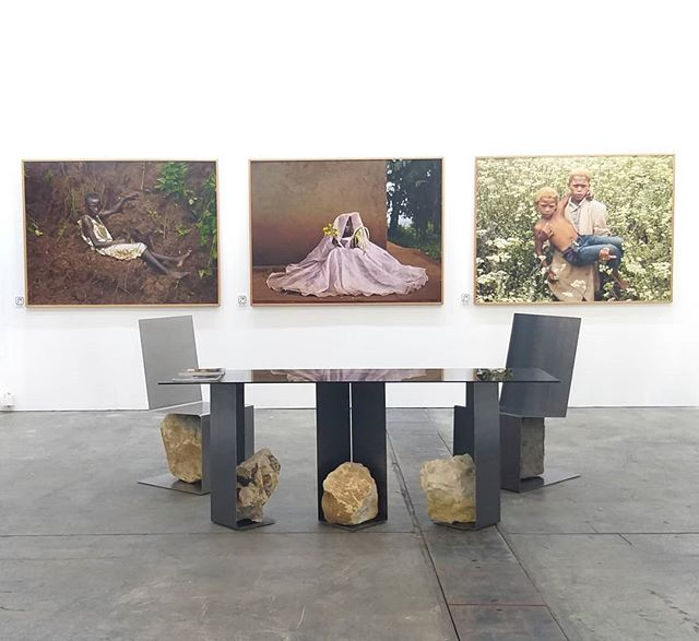 Coexist collection standing silent, below the incredibly beautiful work of #peterhugophotography at @fineartasia.  I'm showing my Shelter Table and Concord Chairs with @pekinfineartsgallery and @design.pier. Join us to marvel over the next few days.