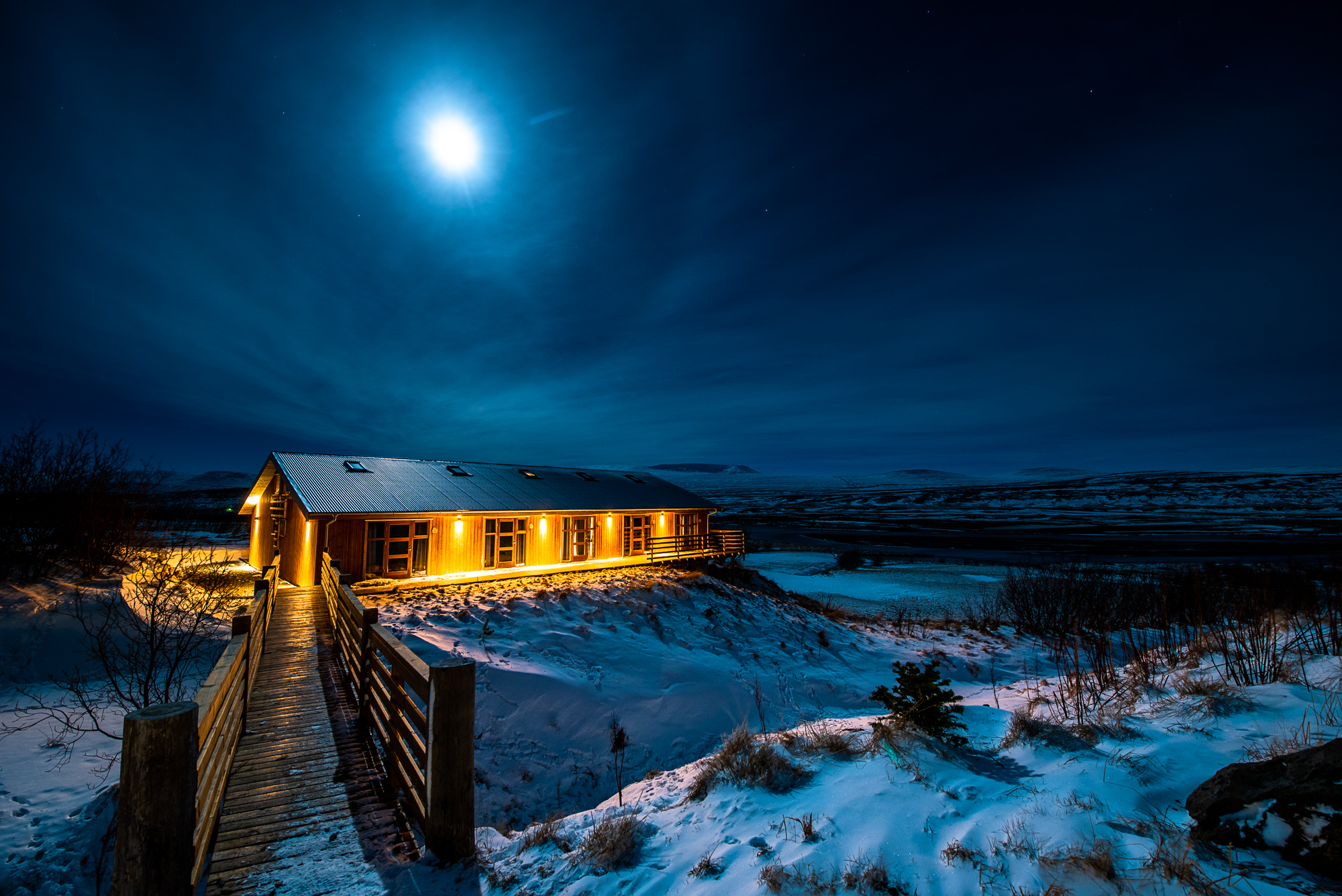 Our beautiful warm log cabin nestled in the icy cold snow of the Iceland Winter Wonderland.