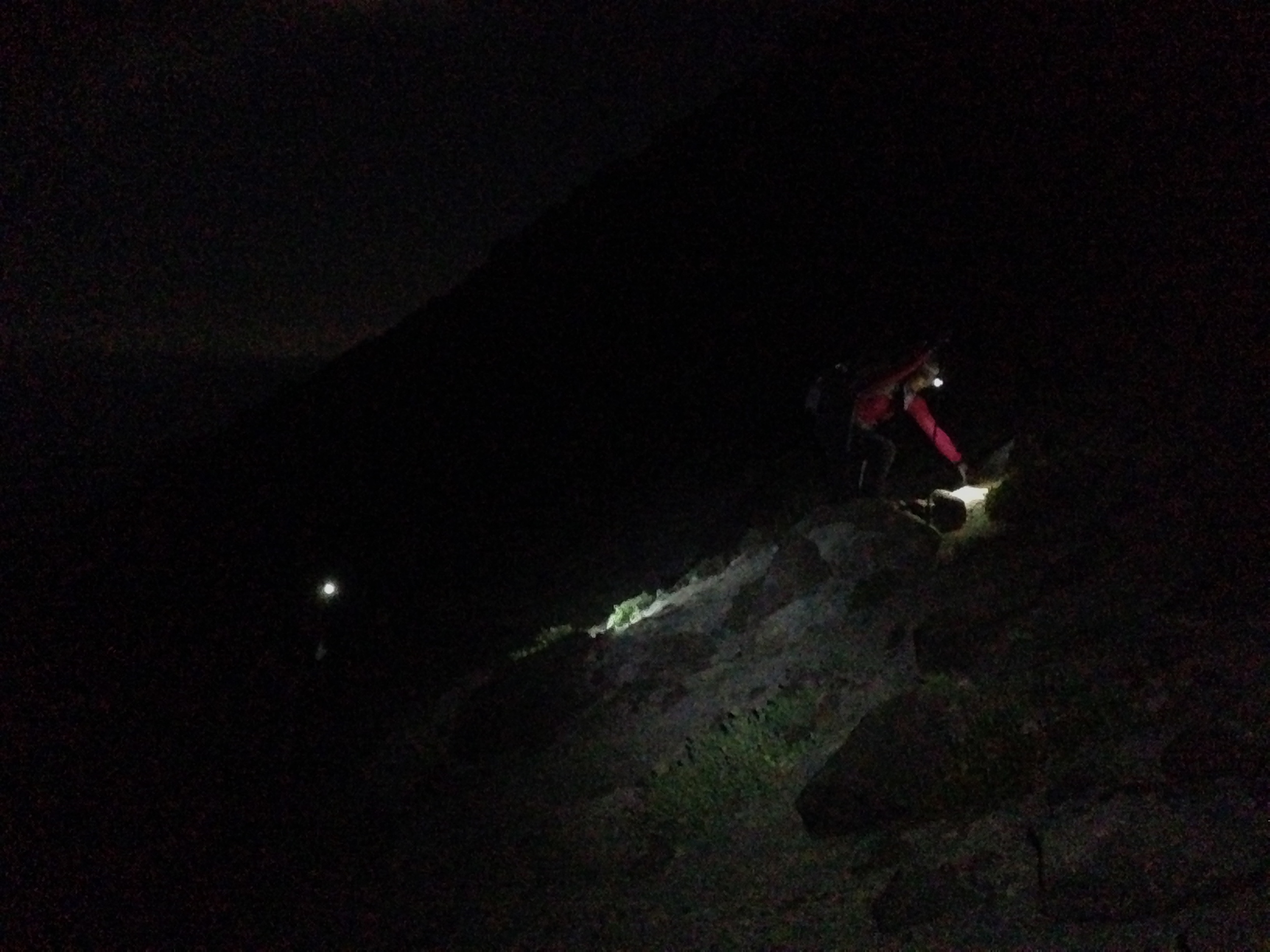 Heading up at midnight via headlamp.