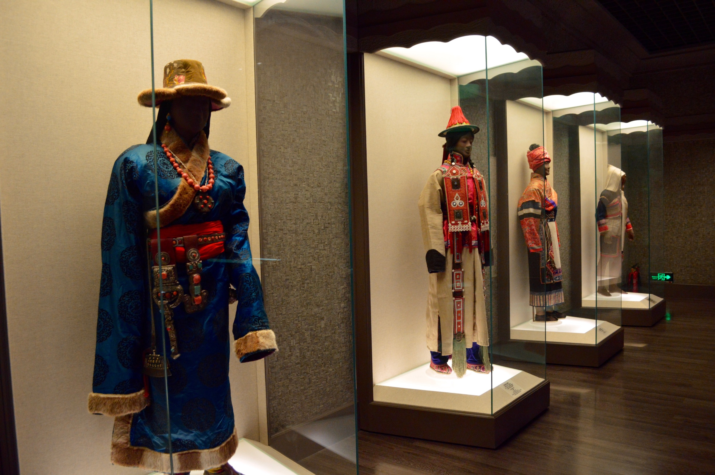 Traditional outfits showcased in the Chinese Minority Nationalities' gallery.