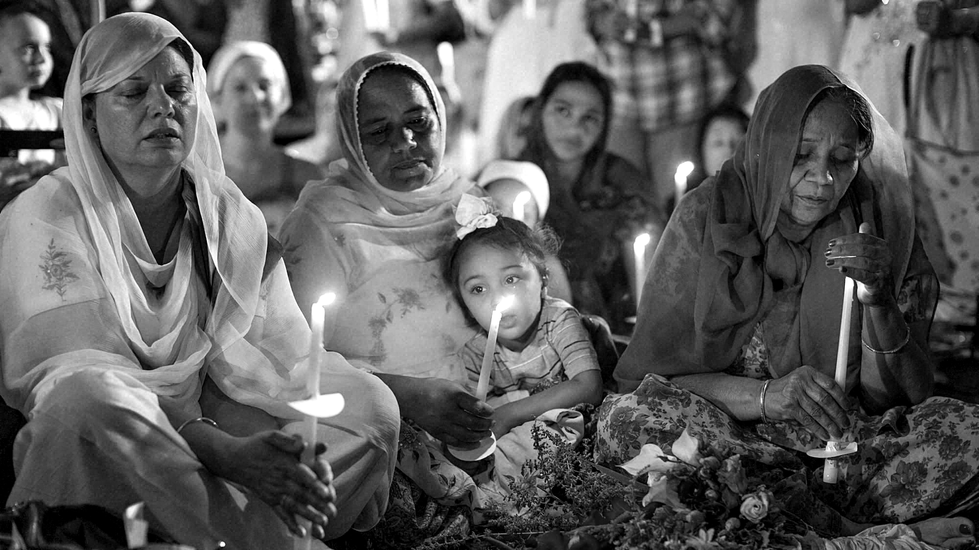 A year after the shooting, the Oak Creek community comes together at The Sikh Temple of Wisconsin to remember the victims and support their families. (Source:  Waking in Oak Creek )