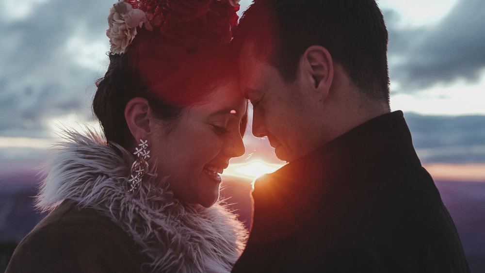 Newly married couple touching foreheads standing in the snow after mountain top elopement at Mount Hotham