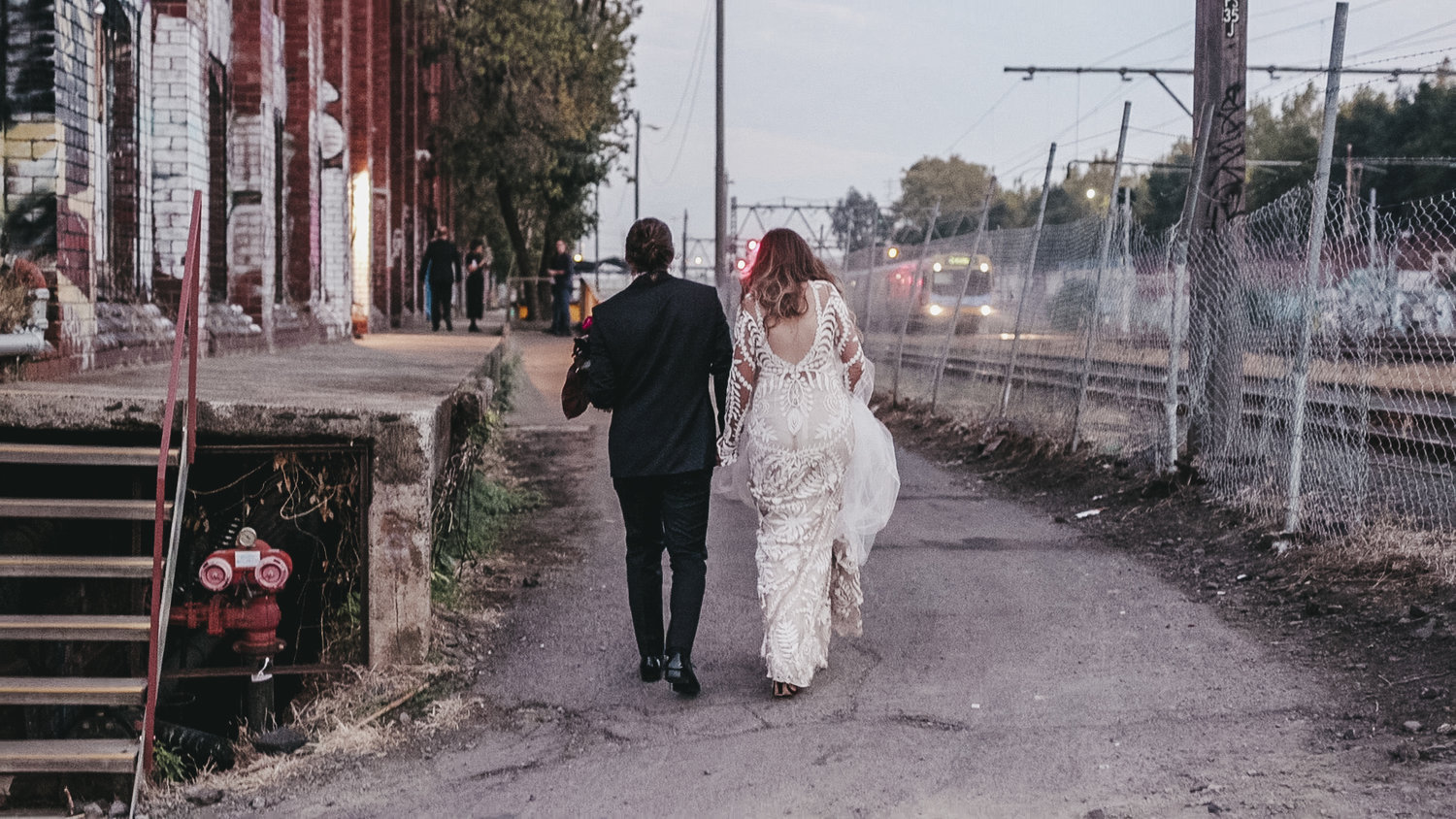 Newly married couple walking to their Melbourne warehouse wedding reception