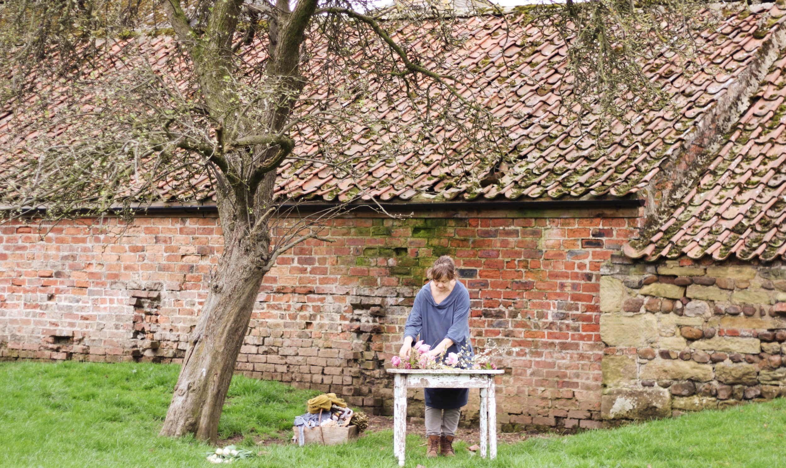 Fiona Pickles in the orchard at Holme Flowers