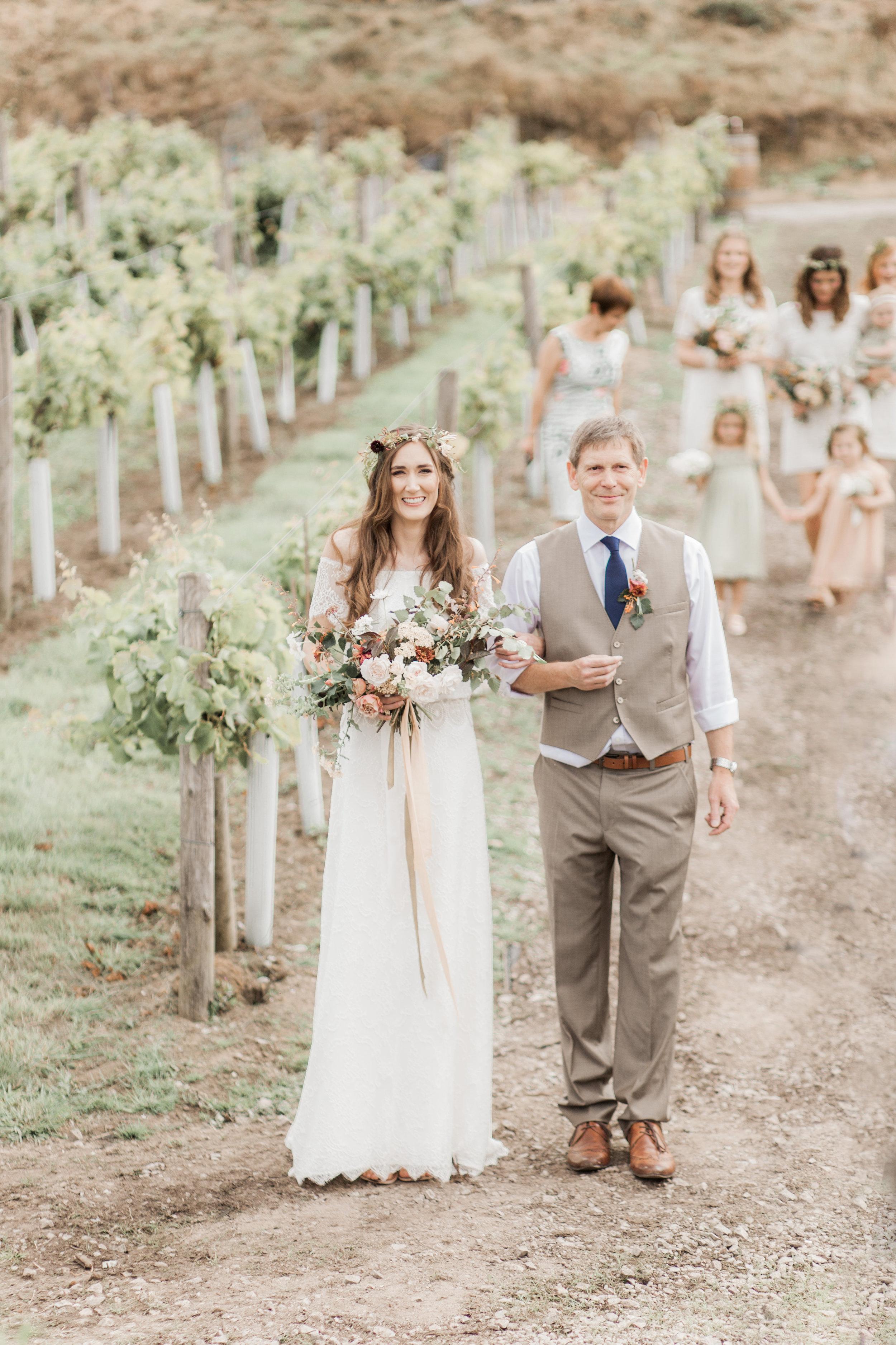 Bride and bridesmaids walking to outdoor ceremony
