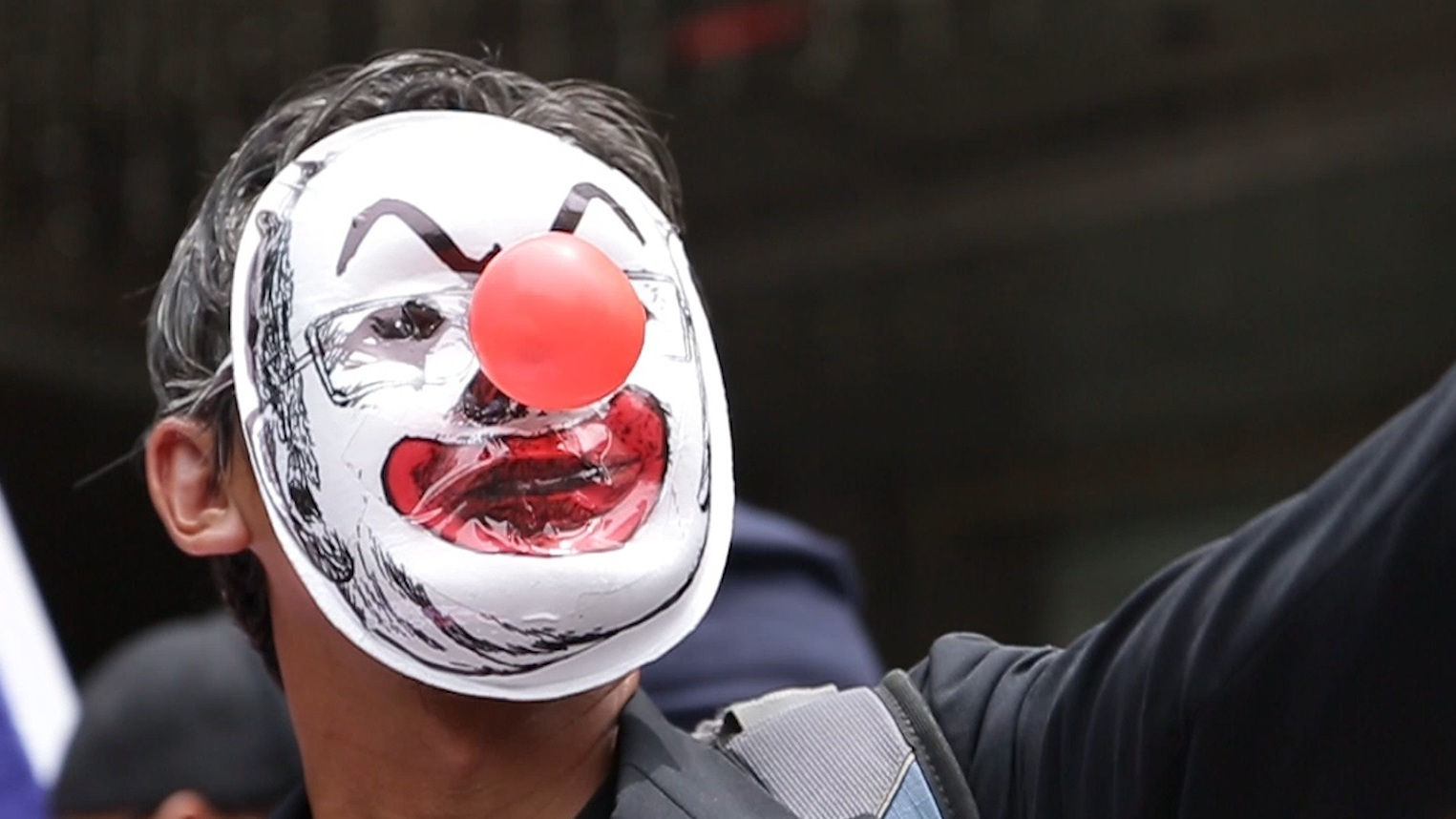 Kelptocrats_DogWoof_02.39_Clown Faced Protester_903977.jpg