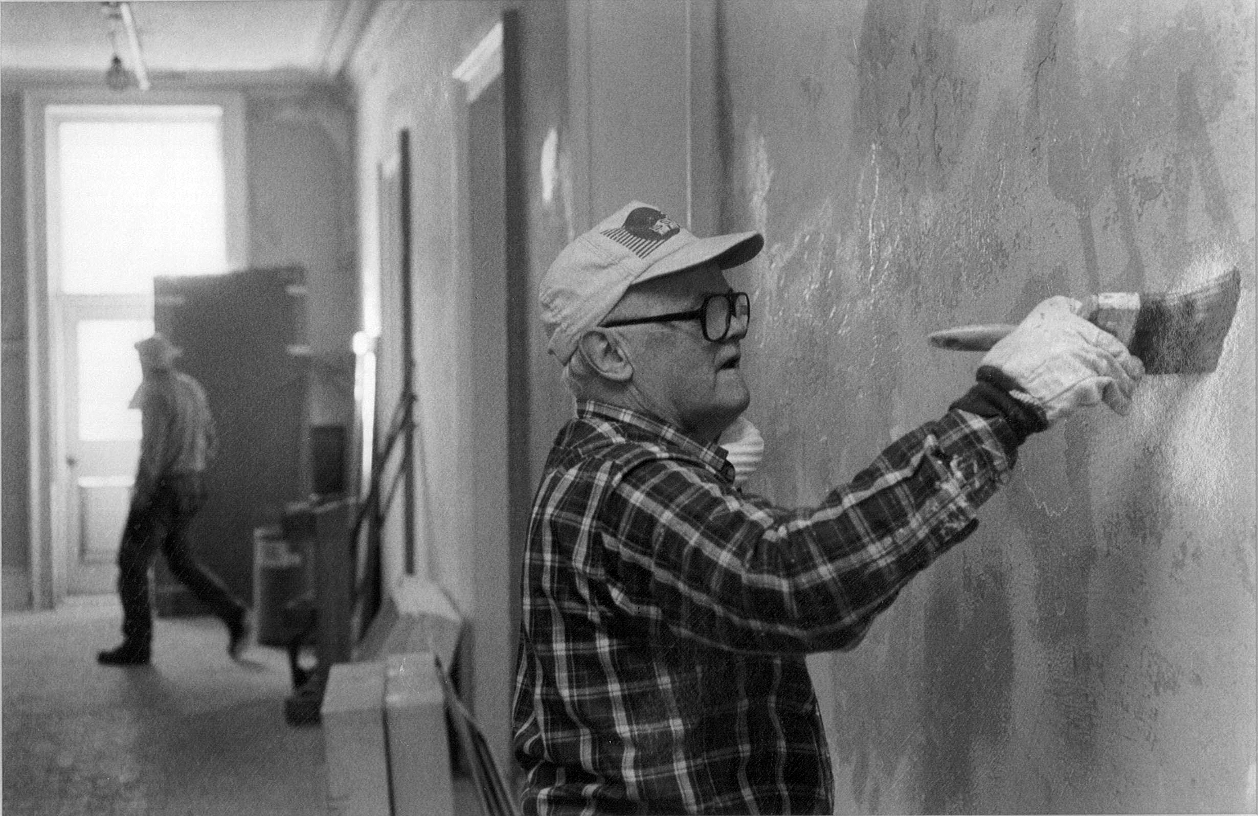 Thomas Rogers Applying PlasterWeld in the second floor corridor