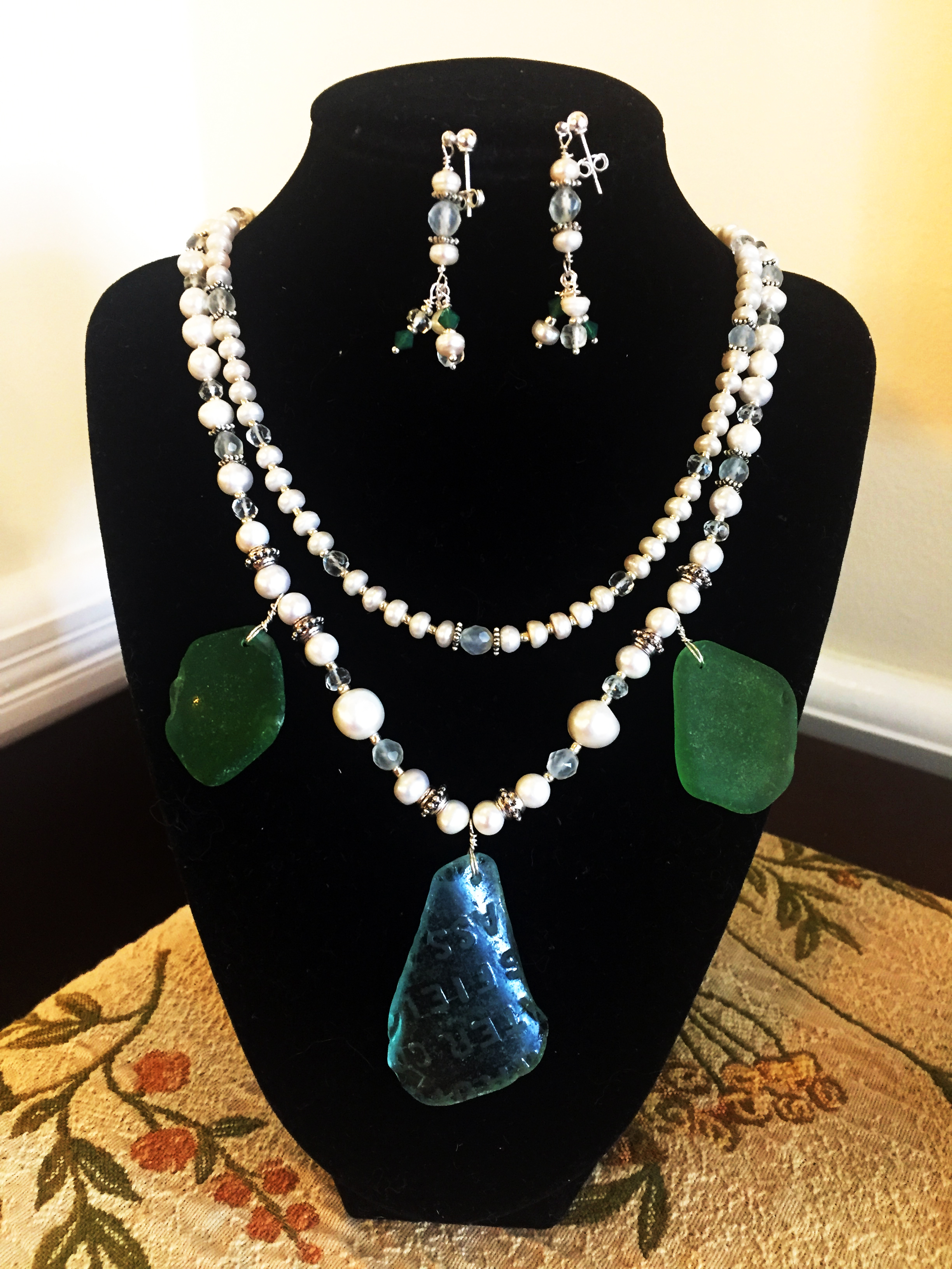 """29. Leslie Petosa, DDS, """"Jewelry made with beach glass from Robbins Reef Lighthouse"""