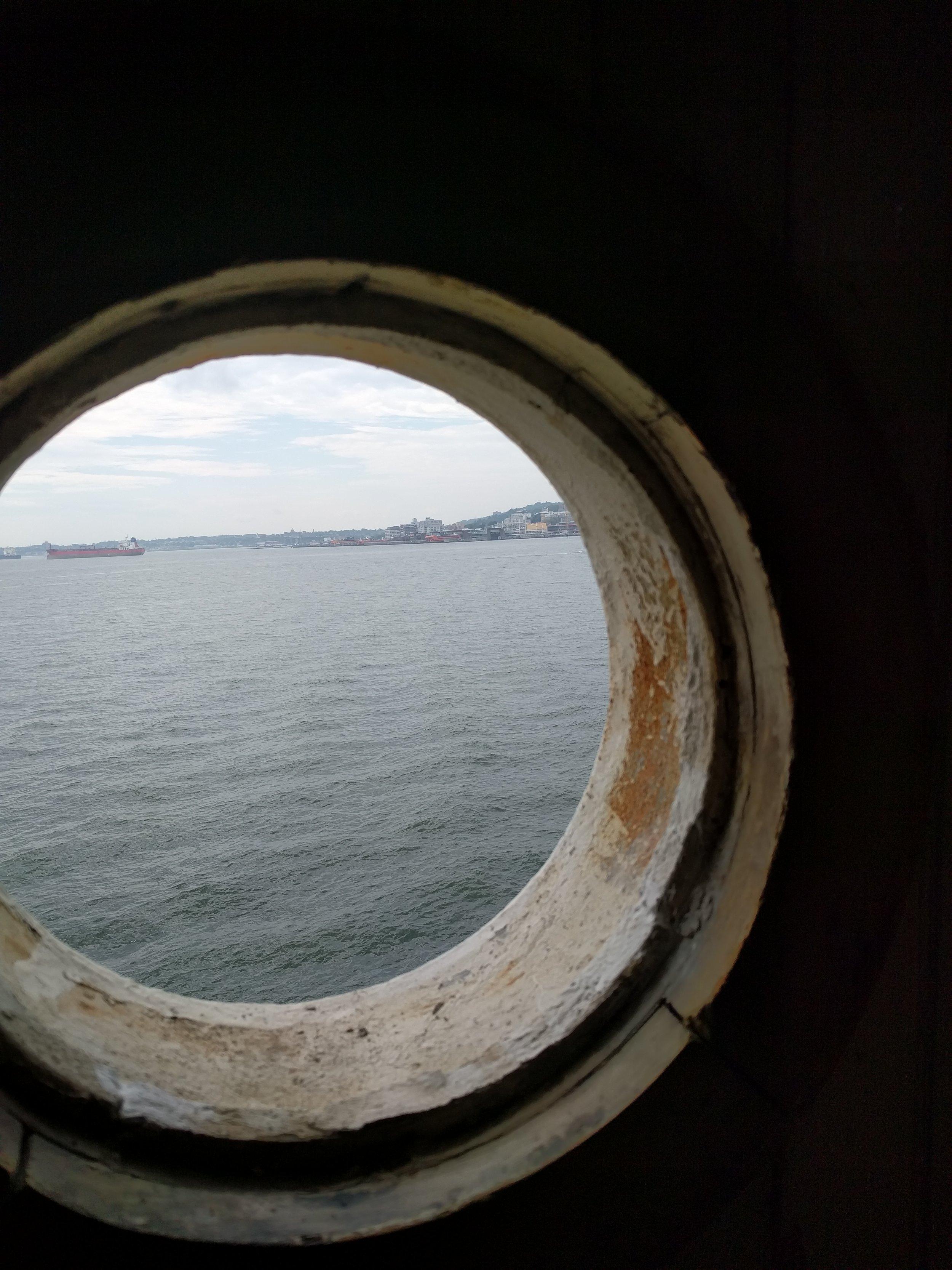 round stationary window without glass.jpg