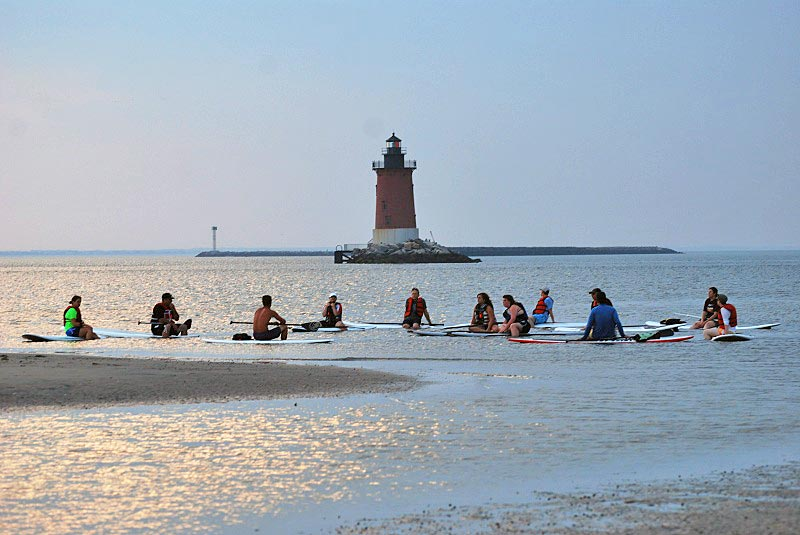 Sunset paddle board at Cape Henlopen