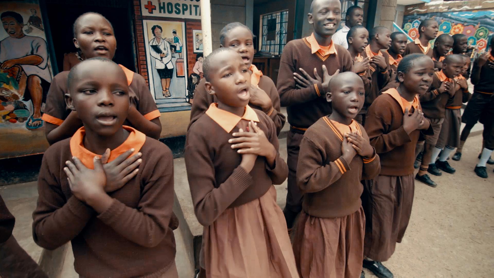 Children Singing at Magoso Primary School in Kibera Slum - Screenshot from Film.png