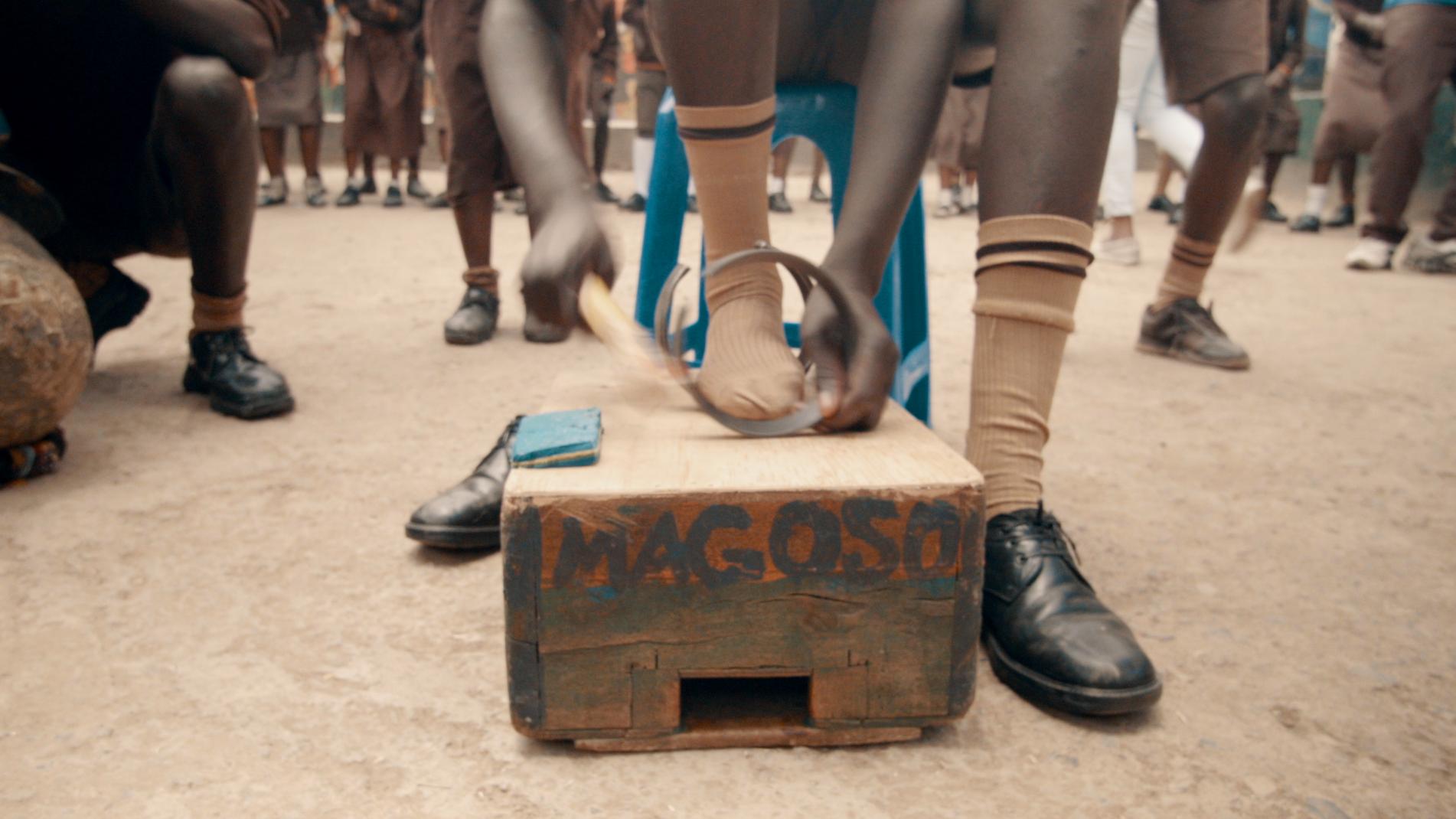 Young Man Drumming at Magoso Primary School in Kibera Slum - Screenshot from Film.png