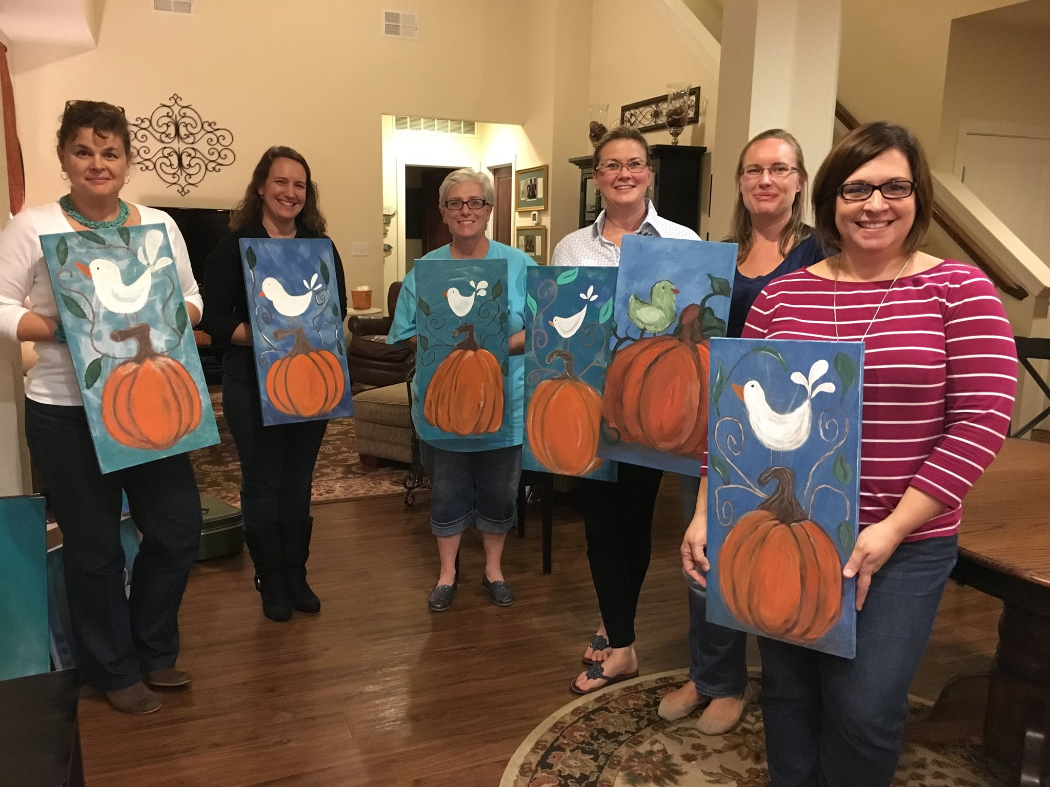 "These lovely military wives did not think they could ""paint or create"". HOWEVER, they all accomplished a Masterpiece. We had so much fun, we laughed about ""nice bottoms"" (on our pumpkins!) and relieved some stress, had a sip or two of wine and just enjoyed life!   Gigi P. hosted the event and she scheduled her second gathering and had a blast again the following month! Thank you ladies for a great time!"