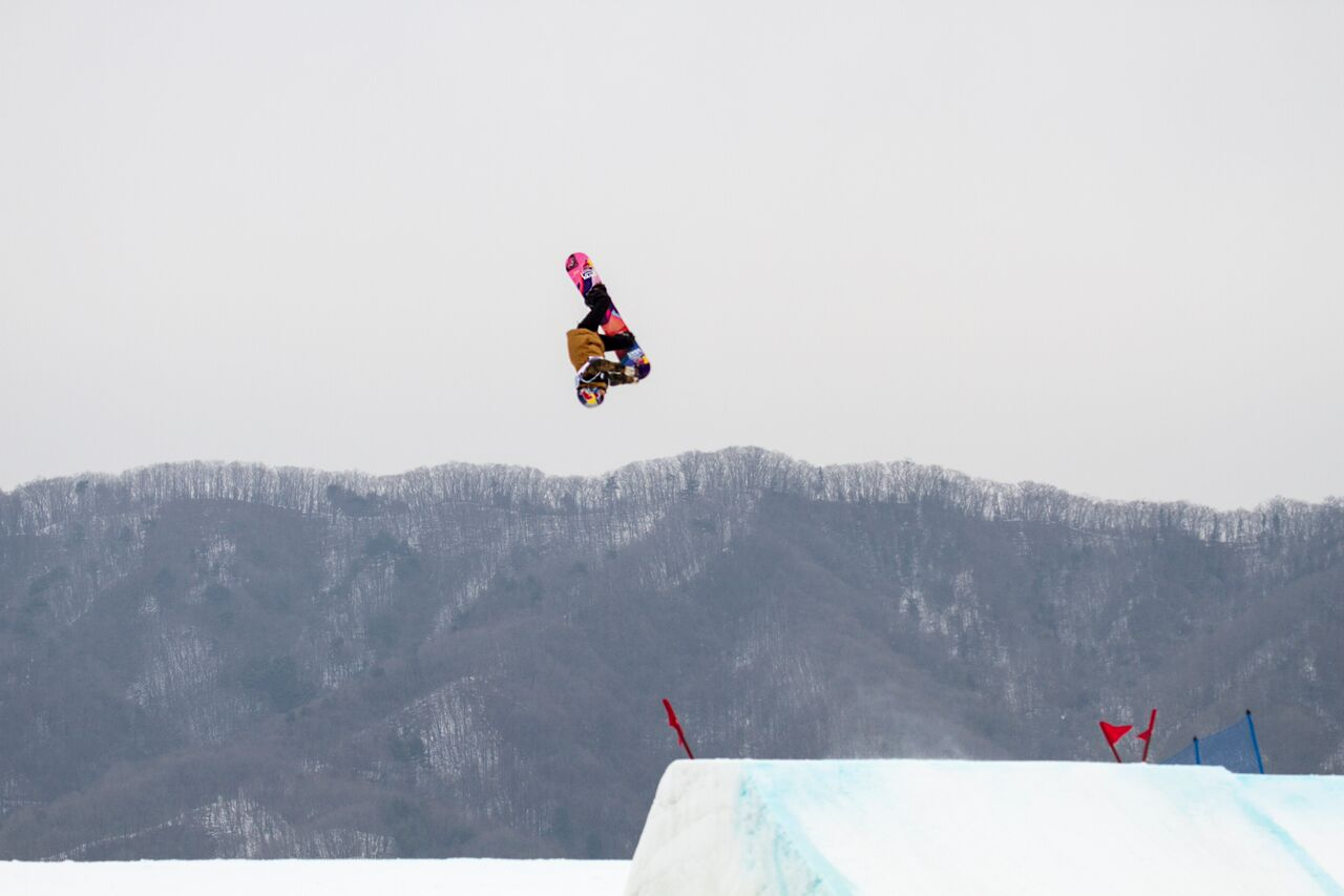 Photo - Jenny Bletchler.Snap shot from the TEST! Cab Underflip Nose grab.