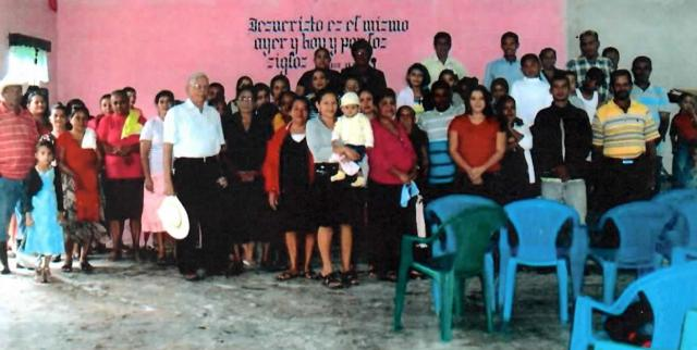 Congregation worshiping before construction