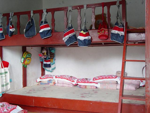 Children sleep 5-6 to a bed