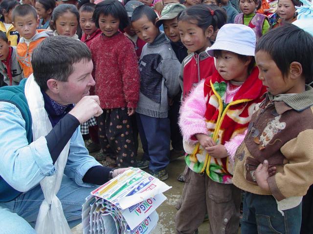 Brad teaching children how to use toothbrush