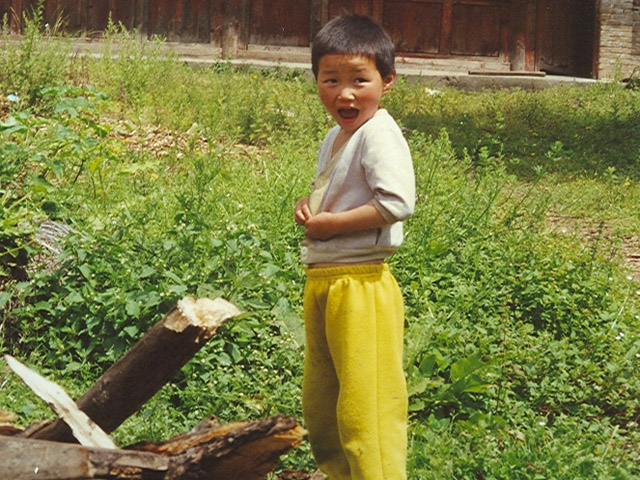 Young boy in village